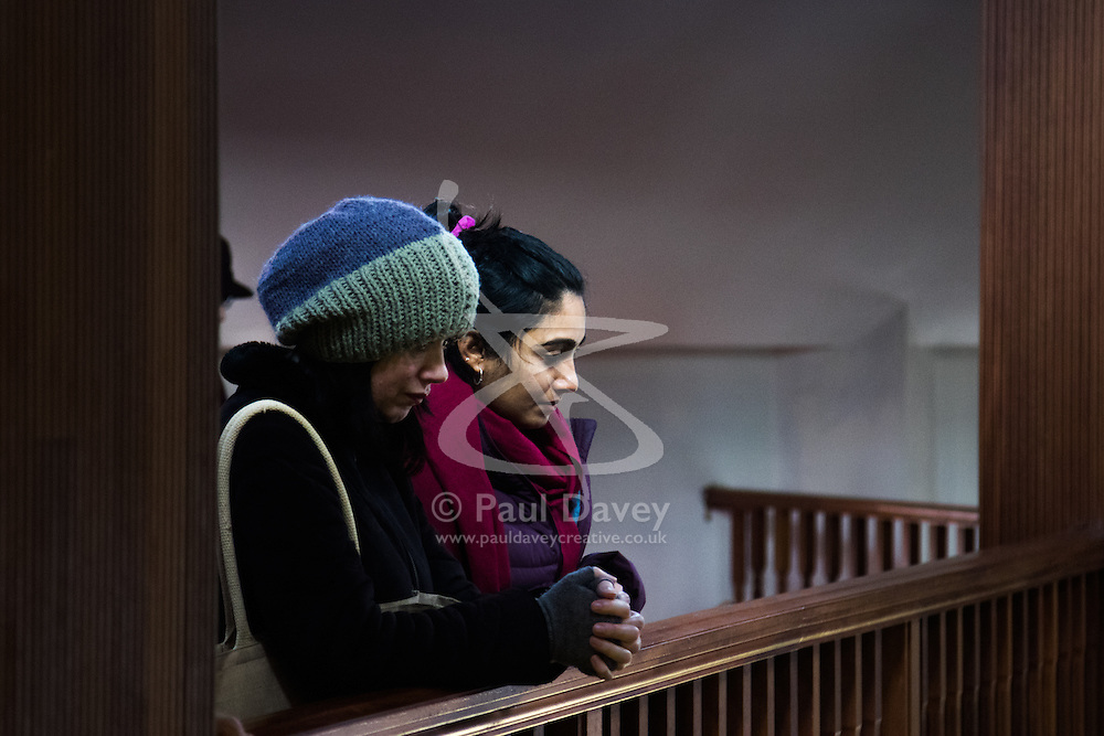 """Finsbury Park Mosque, London, February 7th 2016. Two women watch Muslim men pray from an upper balcony as part of a Visit My Mosque initiative by the Muslim Council of Britain to show non-Muslims """"how Muslims connect to God, connect to communities and to neighbours around them"""".<br /> . ///FOR LICENCING CONTACT: paul@pauldaveycreative.co.uk TEL:+44 (0) 7966 016 296 or +44 (0) 20 8969 6875. ©2015 Paul R Davey. All rights reserved."""