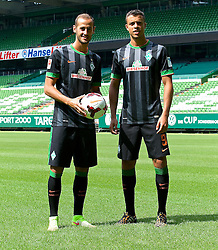 31.07.2014, Trainingsgelände am Weserstadion, Bremen, GER, 1. FBL, SV Werder Bremen Training,  im Bild Alejandro Galvez (SV Werder Bremen #4) und Franco Matías Di Santo / Franco Matias Di Santo (SV Werder Bremen #9) präsentieren das neue Auswärtstrikot für die Saison 2014/2015 // during the training session on the training ground of the German Bundesliga Club SV Werder Bremen at the Weserstadion, Bremen, Germany on 2014/07/31. EXPA Pictures © 2014, PhotoCredit: EXPA/ Andreas Gumz<br /> <br /> *****ATTENTION - OUT of GER*****