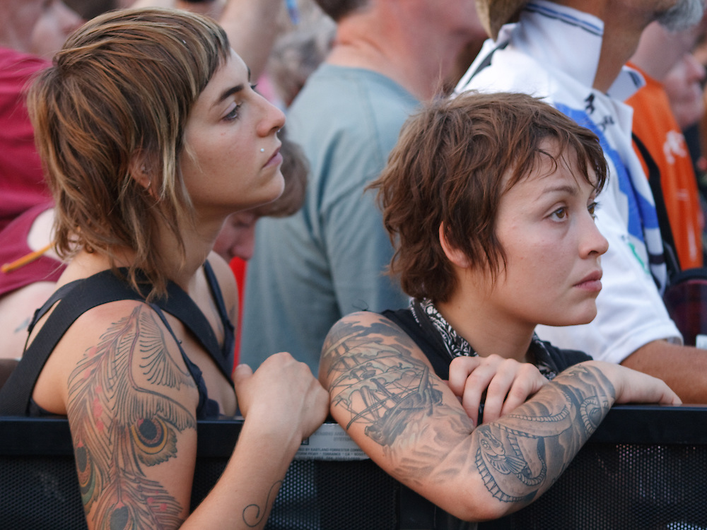 Two tattooed women wait for the music to start at ACL Festival 2008.