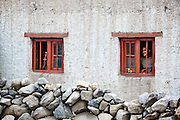 Ladakhi People looking out through their windows in Thiksey village near Leh, Ladakh