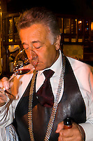Sommelier serving wine to diners, El Otro Sitio restaurant, Bellavista section,  Santiago, Chile