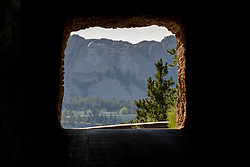 Mt. Rushmore viewed through a tunnel on Iron Mountain Road<br /> <br /> HDR - High Dynamic Range image illustration