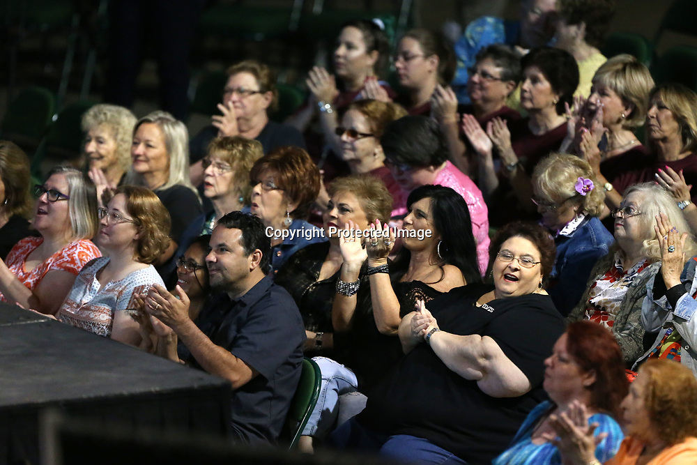 Attendees applaud the gospel music performed by Elvis Tribute Artists Sunday morning at the BancorpSouth Arena in Tupelo. Tribute Artists from this year's Elvis Festival Winner Cote Deonath, to the 2013 winner Jay Dupuis, and many others performed during the gospel concert.