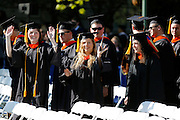 Graduates arrive at the Eastman Quad for the University of Rochester's Commencement Ceremony on Sunday, May 18, 2014.