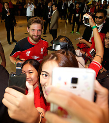 BANGKOK, THAILAND - Monday, July 13, 2015: Liverpool's Joe Allen poses for a selfie with supporters at the Plaza Athenee team hotel in Bangkok on day one of the club's preseason tour. (Pic by David Rawcliffe/Propaganda)
