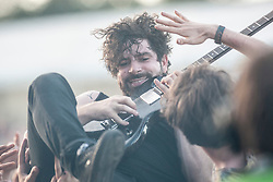 Foals frontman Yannis Philippakis. Radio One, Sunday, T in the Park 2013.<br /> &copy;Michael Schofield.
