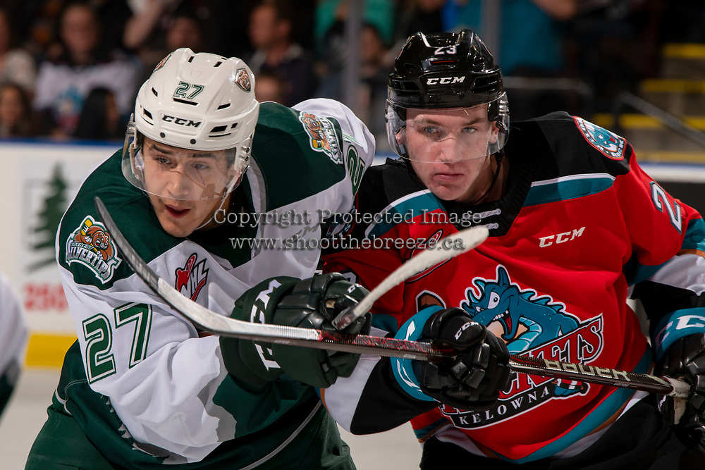 KELOWNA, BC - SEPTEMBER 28:  Forward Jalen Price #27 of the Everett Silvertips checks forward Jake Poole #23 of the Kelowna Rockets during first period at Prospera Place on September 28, 2019 in Kelowna, Canada. (Photo by Marissa Baecker/Shoot the Breeze)