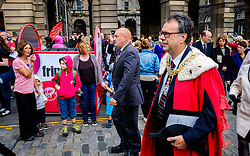 Edinburgh Scotland 7th August 2016 :: Performers from Fringe shows entertain in the High Street to promote their shows.<br /> <br /> Edinburgh's Lord Provost, Donald Wilson makes his way past fringe performers to St Giles Cathedral for Sunday Service.<br /> <br /> (c) Andrew Wilson | Edinburgh Elite media