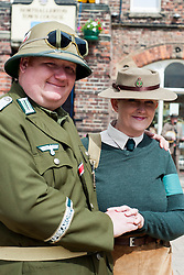 Dressed in his Afrika Corps Officers uniform Northern World War Two Assciation Renactor Robin Carr proposed to Girlfriend Suzanne Colclough, who was dressed in her British Land Army Outfit, in the Town Square at Northallerton during the Charity Wartime Weekend on Saturday 15th June. Robin has organised the charity fundraising weekend for the event for the past four years raising money for various Military Charities including Help For Heroes and the Ben Hyde Memorial Trust.<br /> <br /> 15 June 2013<br /> Image &copy; Paul David Drabble<br /> www.pauldaviddrabble.co.uk