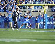 Ole Miss' Charles Sawyer (3) tackles Kentucky's Matt Roark (3) at Commonwealth Stadium in Lexington, Ky. on Saturday, November 5, 2011. Kentucky won 30-13...