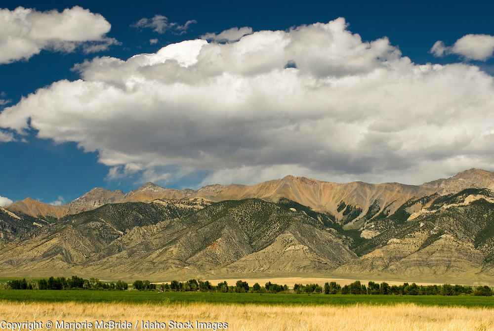 Clouds form over the Lost River Mountain Range and agricultural fields near Arco, Idaho.