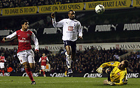 Photo: Paul Thomas.<br /> Tottenham Hotspur v Arsenal. Calring Cup, Semi Final 1st Leg. 24/01/2007.<br /> <br /> Jermain Defoe (White) of Spurs has his great goal chance stopped by Arsenal's keeper Manuel Almunia