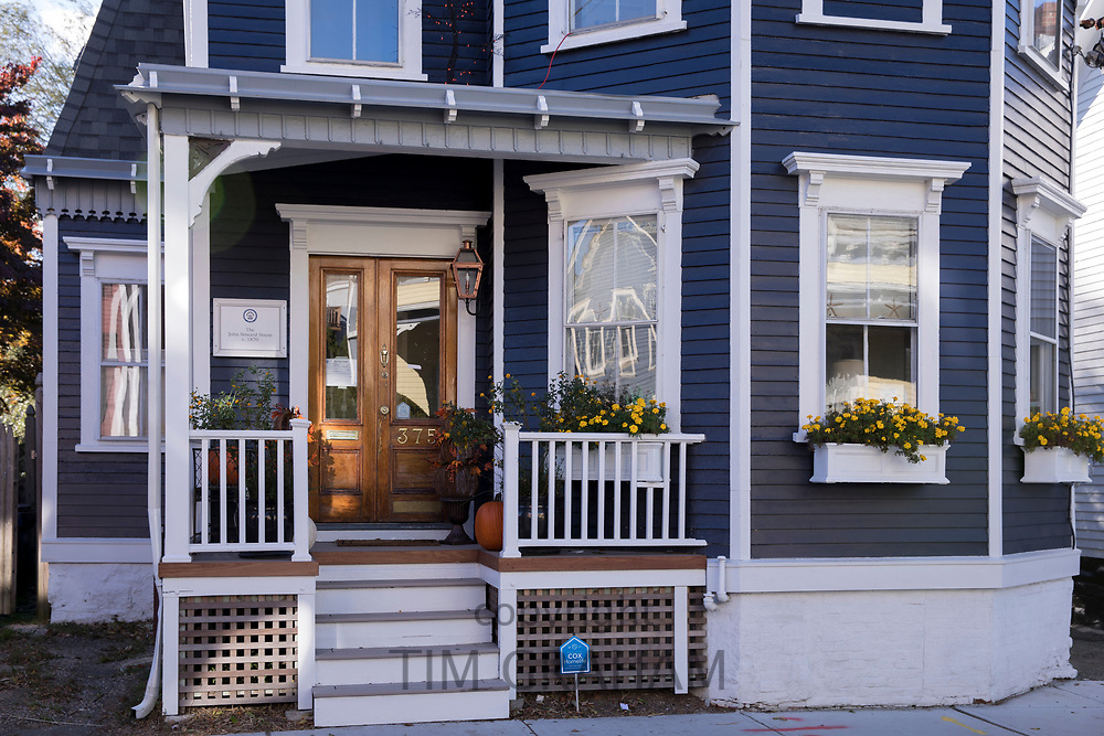 Typical traditional neat painted wooden clapboard house with front stoop in Newport, Rhode Island, USA
