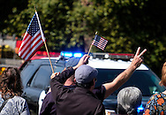 People salute as the hearse carrying the body of Whittier Police Officer Keith Boyer arrives at Rose Hills Memorial Park in Whittier, Calif., Friday, March 3, 2017. Boyer, who was fatally shot after responding to a traffic crash, was remembered today by thousands of law enforcement officers, friends and family as a dedicated public servant, talented drummer, loving friend and even a ``goofy'' dad.(Photo by Ringo Chiu/PHOTOFORMULA.com)<br />