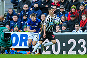 Miguel Almiron (#24) of Newcastle United controls the ball after stealing possession from Jonjoe Kenny (#43) of Everton during the Premier League match between Newcastle United and Everton at St. James's Park, Newcastle, England on 9 March 2019.