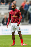 Alexandre Lacazette (#9) of Arsenal warms up ahead of the Premier League match between Newcastle United and Arsenal at St. James's Park, Newcastle, England on 15 September 2018.