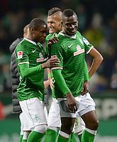 FUSSBALL   1. BUNDESLIGA   SAISON 2013/2014   11. SPIELTAG SV Werder Bremen - Hannover 96                         03.11.2013 Cedrick Makiadi, Davie Selke und Assani Lukimya (v.l., alle SV Werder Bremen) freuen sich nach dem Abpfiff