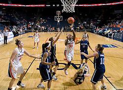 Virginia center Aisha Mohammed (33) shoots over Rhode Island forward Erin Cournoyer (44).  The Virginia Cavaliers women's basketball team defeated the Rhode Island Rams 89-53 at the John Paul Jones Arena in Charlottesville, VA on January 9, 2008.