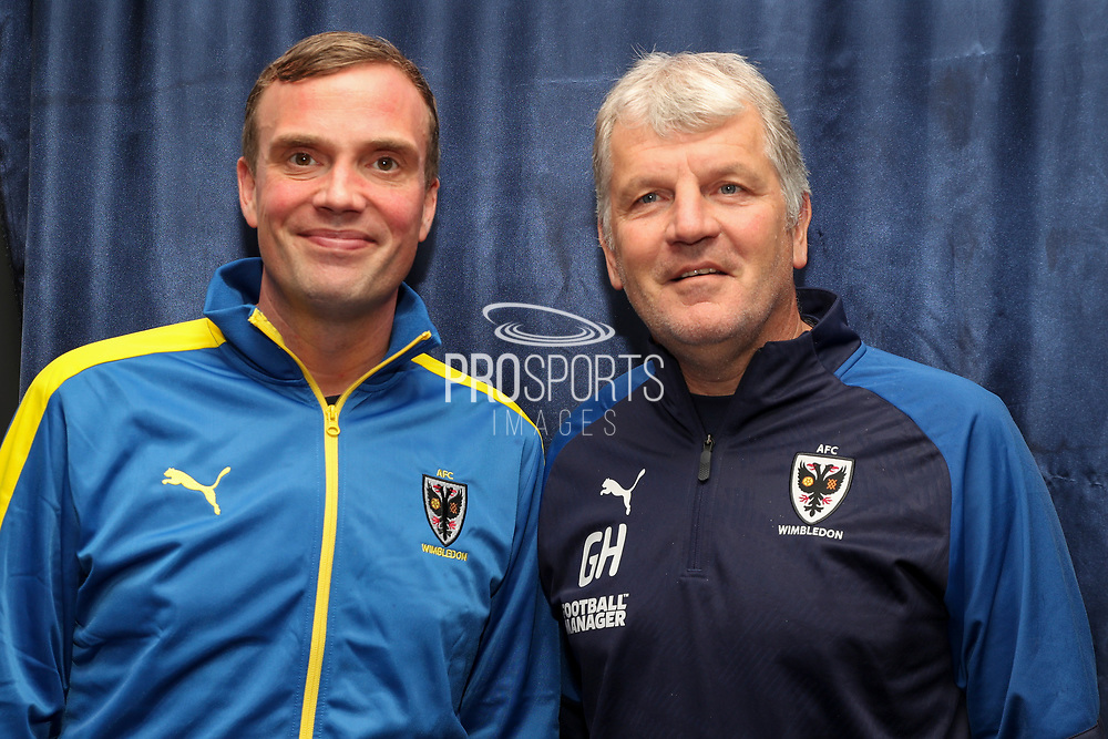 AFC Wimbledon manager Glyn Hodges with sponsor (12th man during the EFL Sky Bet League 1 match between AFC Wimbledon and Gillingham at the Cherry Red Records Stadium, Kingston, England on 23 November 2019.