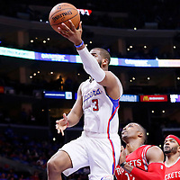 14 May 2015: Los Angeles Clippers guard Chris Paul (3) goes for the layup past Houston Rockets center Dwight Howard (12) and Houston Rockets forward Josh Smith (5) during the Houston Rockets 119-107 victory over the Los Angeles Clippers, in game 6 of the Western Conference semifinals, at the Staples Center, Los Angeles, California, USA.