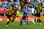 Lucas Akins challenges for the ball with Stephen Dawson (C)  during the Sky Bet League 1 match between Burton Albion and Scunthorpe United at the Pirelli Stadium, Burton upon Trent, England on 8 August 2015. Photo by Aaron Lupton.