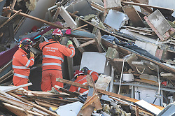 © Licensed to London News Pictures. 27/12/2018. Andover, UK. Members of an Urban Search and Rescue team examine the ruins of the kitchen of a house in Andover, Hampshire where a mans body has been pulled from wreckage, following an explosion in the property. Residents have been evacuated form the area following a blast in the early hours of this morning. Photo credit: Peter Macdiarmid/LNP