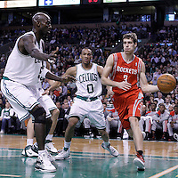 06 March 2012: Houston Rockets point guard Goran Dragic (3) drives past Boston Celtics shooting guard Avery Bradley (0) and Boston Celtics power forward Kevin Garnett (5) during the Boston Celtics 97-92 (OT) victory over the Houston Rockets at the TD Garden, Boston, Massachusetts, USA.