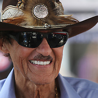 Richard Petty smiles in the pit area during the 57th Annual NASCAR Coke Zero 400 race first practice session at Daytona International Speedway on Friday, July 3, 2015 in Daytona Beach, Florida.  (AP Photo/Alex Menendez)
