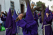 Hooded penitents during the Procession of Silence through the streets on Good Friday during Holy Week March 30, 2018 in Querétaro, Mexico. The penitents, known as Nazarenes, carry heavy crosses and drag chains in a four hour march to relive the pain and suffering during the passion of Christ.