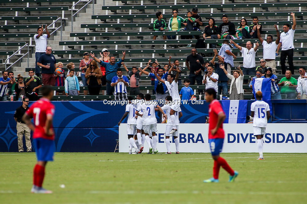 Honduras celebrates their goal against Costa Rica in the second half of a CONCACAF men's Olympic qualifying soccer match in Carson, Calif., Sunday, Oct. 4, 2015. Honduras won 2-0. (AP Photo/Ringo H.W. Chiu)