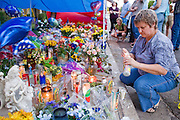 22 SEPTEMBER 2007 -- PHOENIX, AZ: CAROL CONDIT, of Phoenix, lights candles for Phoenix Phoenix Police Officer Nick Erfle who was murdered Tuesday, Sept. 18, when he stopped a young man for jaywalking on a Phoenix street. The man, Erik Martinez, was an illegal immigrant with a lengthy criminal history who had been deported from the United States and snuck back in. He was a member of a Mexican gang and wanted on felony assault warrants, which is why he shot Erfle when he was stopped for jaywalking. Martinez carjacked a passing vehicle in an effort to escape but was shot and killed a few miles from where he killed Erfle. Photo by Jack Kurtz / ZUMA Press