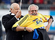 FC Luzern president Walter STIERLI (L) presents former player Paul WOLFISBERG, who played his first match 60 years ago, with a special jersey prior to the AXPO Super League (National League A) soccer match between FC Luzern (FCL) and FC Basel (FCB) at the Gersag stadium in Emmenbruecke, Switzerland, Sunday, February 27, 2011. (Photo by Patrick B. Kraemer / MAGICPBK)