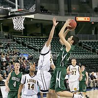 Eldine Dilberovic (10) scores two on a jump shot against Darin Ross (24).
