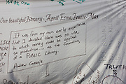 Protest banner messages including one quoting steel magnate Andrew Carnegie outside Carnegie Library in Herne Hill, south London while occupiers remain inside the premises on day 6 of its occupation, 5th April 2016. The angry local community in the south London borough have occupied their important resource for learning and social hub for the weekend. After a long campaign by locals, Lambeth have gone ahead and closed the library's doors for the last time because they say, cuts to their budget mean millions must be saved.