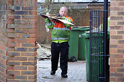 © Licensed to London News Pictures. 06/01/2014<br /> Maidstone Council workmen clear out property in Acott Fleids,Yalding.<br /> Yalding village Flood water starts receding again as a clear up operation starts.<br /> The village in Kent also gets a visit from the new Kent Police Chief Constable Alan Pughsley and Kent Police Commissioner Ann Barnes who walked around Little Venice Country Park meeting residents.  Alan Pughsley has been in the post since January 4th 2014.<br /> Photo credit :Grant Falvey/LNP