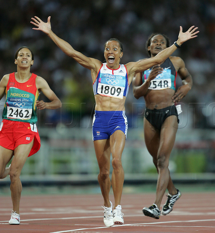 ATHENS, GREECE - Kelly Holmes of Great Britain celebrates after winning the Gold Medal in the Women's 800m on Monday, August 23, 2004 at Olympics Stadium.