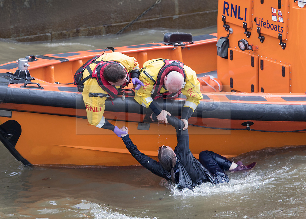 London News Pictures in 2017**<br /> © Licensed to London News Pictures. 29/03/2017. London, UK. An RNLI crew pull a person from the River Thames under Westminster Bridge. This is the second person who has jumped in to the River from Westminster bridge in the space of two hours. Police are still searching for the first person. Photo credit: Peter Macdiarmid/LNP