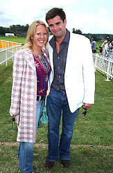 MISS ALICE BAMFORD and JAKE HEIMONN at the Veuve Clicquot sponsored Gold Cup or the British Open Polo Championship won by The  Azzura polo team who beat The Dubai polo team 17-9 at Cowdray Park, West Sussex on 18th July 2004.