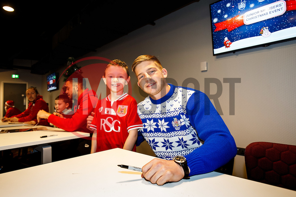 Auguy Slowik of Bristol Rugby poses with a young supporter as Season ticket holders and members of Bristol Sport 7s and Forever Bristol take part in a Bristol Sport Christmas Party - Mandatory byline: Rogan Thomson/JMP - 22/12/2015 - SPORT - Ashton Gate Stadium - Bristol, England - Bristol Sport Christmas at Ashton Gate.