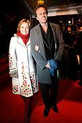 Premiere Wit Licht in Tuschinski, Amsterdam<br /> <br /> Op de foto: Pieter van den Hoogenband en Yvon Jaspers