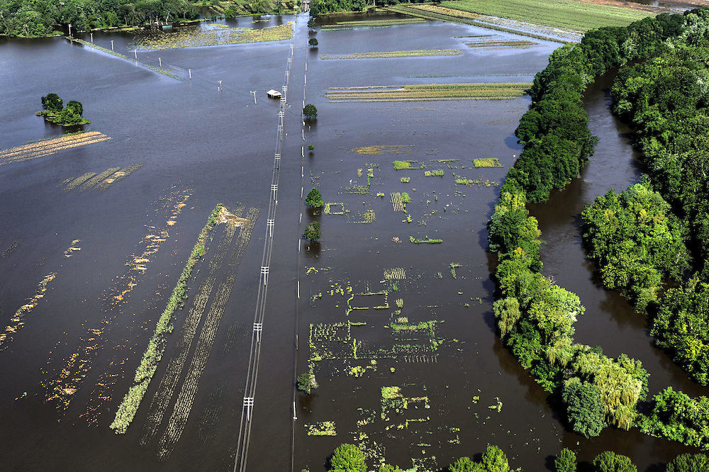 Flooding over a road from the Farmington River is seen in the aftermath of Tropical Storm Irene, in Simsbury, Conn., Monday, Aug. 29, 2011.  (AP Photo/Jessica Hill)
