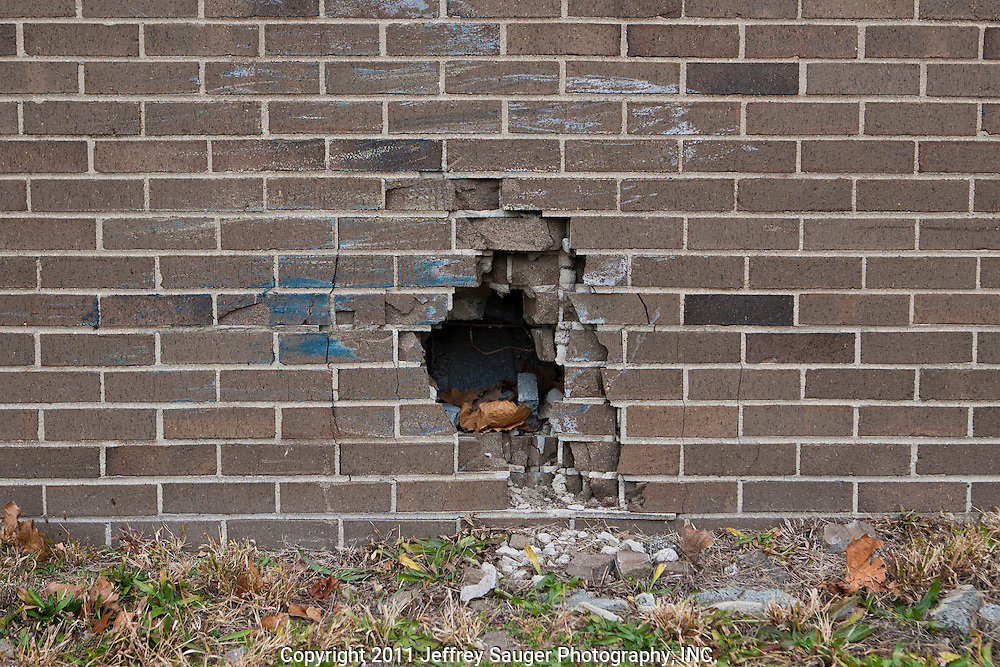 DETROIT, MI - NOVEMBER, 16: A hole in an exterior wall of Farwell Middle School, in Detroit, MI, Tuesday, November 16, 2010. Mice have been entering through the hole. (Photo by Jeffrey Sauger)