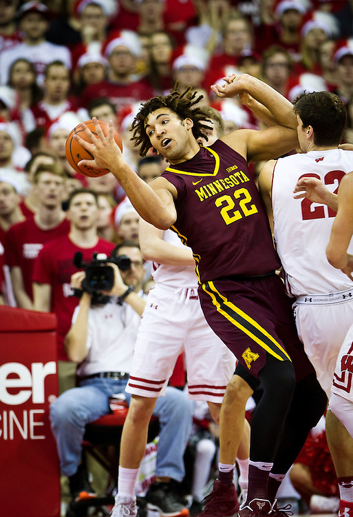 Just Out of Reach. Center Reggie Lynch (22) fumbles with a loose ball during the first half of the University of Minnesota Men's Basketball game versus University of Wisconsin on March 5, 2017.