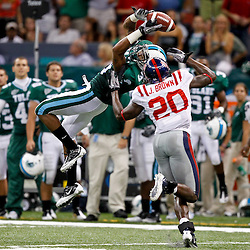 Sep 11, 2010; New Orleans, LA, USA; Tulane Green Wave wide receiver Ryan Grant (3) attempts to make a reception over Mississippi Rebels safety Johnny Brown (20) during the second half at the Louisiana Superdome. The Mississippi Rebels defeated the Tulane Green Wave 27-13.  Mandatory Credit: Derick E. Hingle