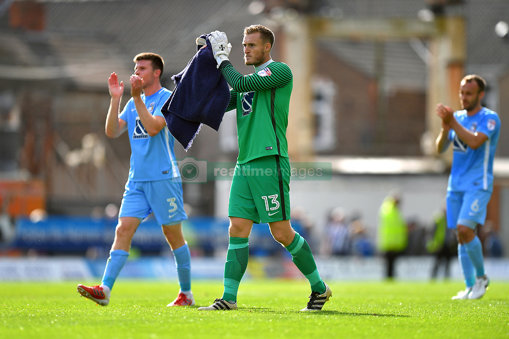 Coventry City's 	Chris Stokes (left) and goalkeeper Liam O'Brien applaud the travelling support at the end of the game