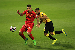 1 May 2017 - Premier League - Watford v Liverpool - Roberto Firmino of Liverpool tangles with Adrian Mariappa of Watford - Photo: Marc Atkins / Offside.