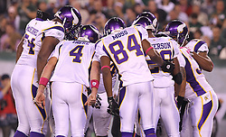 Oct 11, 2010; East Rutherford, NJ, USA; Minnesota Vikings quarterback Brett Favre (4) and Minnesota Vikings wide receiver Randy Moss (84) talk in the huddle during the first half at the New Meadowlands Stadium.