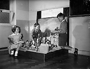 04/06/1959<br /> 06/04/1959<br /> 04 June 1959<br /> Children's exhibition at Roslyn Park Convent. Cynthia Yates (7), 23 Durham Road, Sandymount, Dublin; Tony Ryan (8), Kilmurray Grove, Kilmacanogue, Co. Wicklow and John Hughes (8), 42 Seafort Avenue, Sandymount, Dublin putting the finishing touches to their Esso model. Special for Esso.