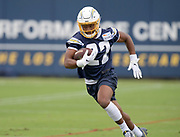 Jun 3, 2019; Costa Mesa, CA, USA; Los Angeles Chargers running back Justin Jackson (22) carries the ball  during organized team activities at the Hoag Performance Center.