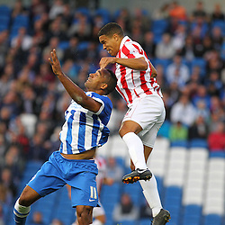 Cheltenham Town's Tony Brown wins the ball during the English Capital One Cup 1st Round between Brighton & Hove Albion FC and Cheltenham Town FC at the American Express Community Stadium, Brighton, 12th August 2014 © Phil Duncan | SportPix.org.uk